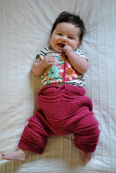 I don't know what that means, but it sounds terrible, so here's a picture of a baby wearing knitted breeches.