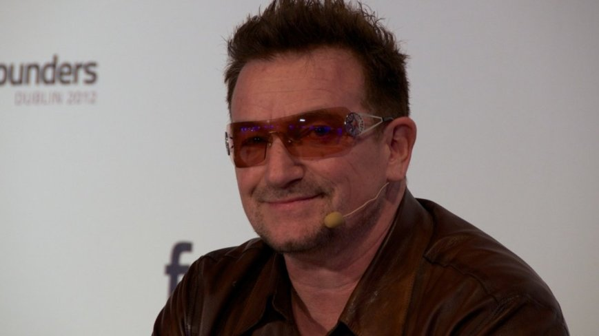 Such as flipping off Bono.