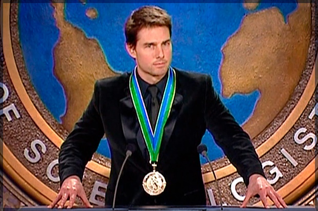 Tom Cruise, shown at a Scientology event, accepting a medal, presumably for being Tom Cruise.